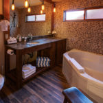 Cottage #15: Air-Tub for two, granite counter-top, stone tile, custom made cabinets